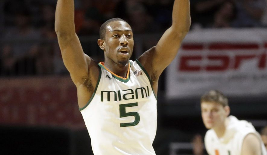 Miami guard Davon Reed (5) celebrates afters scoring a 3-point basket against Florida State during the first half of an NCAA college basketball game, Saturday, Jan. 9, 2016, in Coral Gables, Fla. (AP Photo/Alan Diaz)