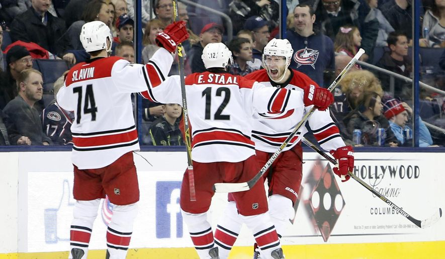 Carolina Hurricanes' Jordan Staal, right, celebrates his game-winning goal against the Columbus Blue Jackets during the third period of an NHL hockey game Saturday, Jan. 9, 2016, in Columbus, Ohio. The Hurricanes beat the Blue Jackets 4-3 in overtime. (AP Photo/Jay LaPrete)