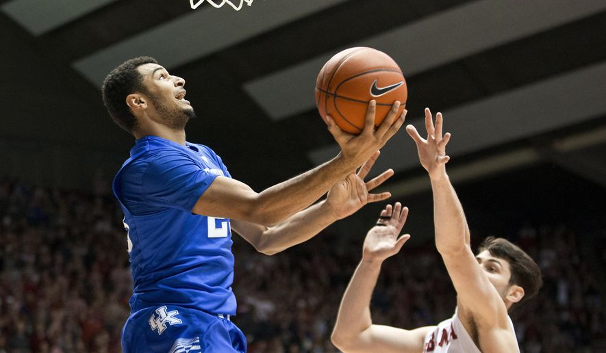 Kentucky guard Jamal Murray, left, jumps to score against Alabama forward Riley Norris during the first half of an NCAA college basketball game Saturday, Jan. 9, 2016, in Tuscaloosa, Ala. (AP Photo/Brynn Anderson)