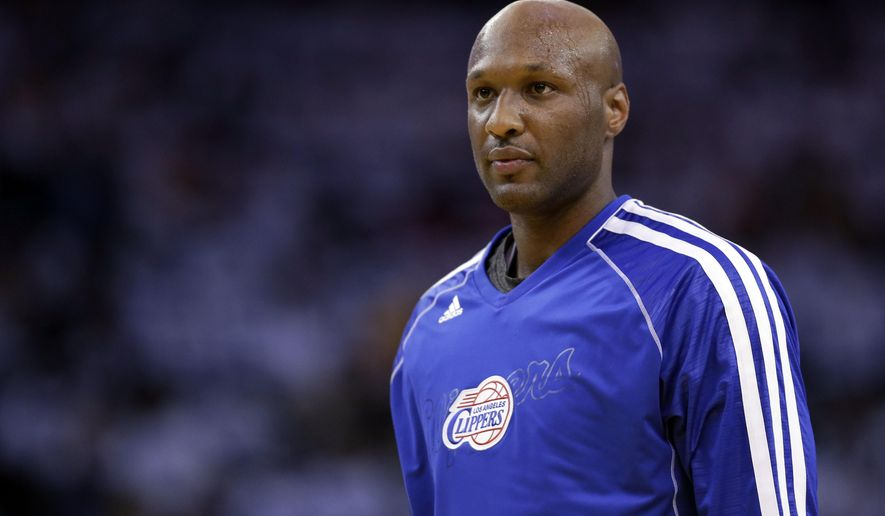 FILE - This Jan. 2, 2013, file photo shows Los Angeles Clippers' Lamar Odom during an NBA basketball game against the Golden State Warriors in Oakland, Calif.  Odom has been transferred from a Los Angeles hospital to a private facility. But there's no word on his condition, three months after he was found unconscious and in critical condition at a Nevada brothel. Family spokeswoman Alvina Alston says Friday, Jan. 8, 2016 that Odom was released from the hospital earlier in the week.  (AP Photo/Marcio Jose Sanchez, File)