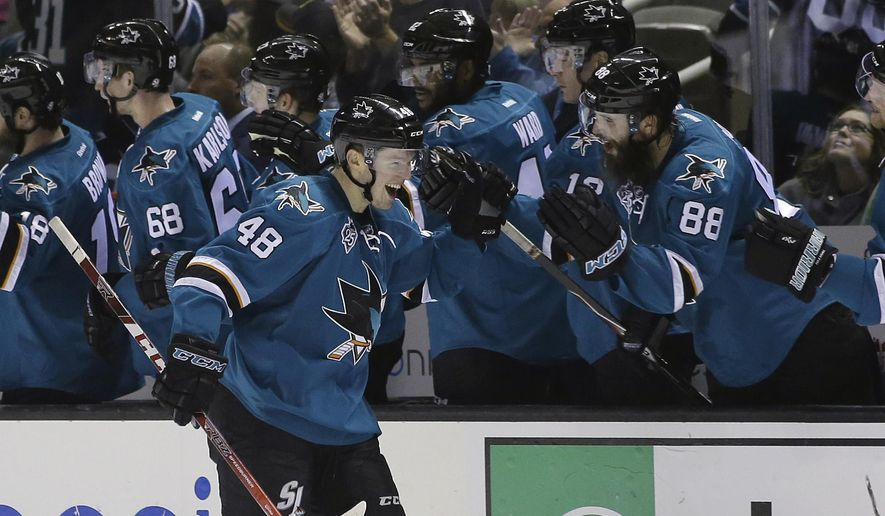 San Jose Sharks' Tomas Hertl (48) celebrates with teammates after his goal against the Toronto Maple Leafs during the second period of an NHL hockey game Saturday, Jan. 9, 2016, in San Jose, Calif. (AP Photo/Marcio Jose Sanchez)