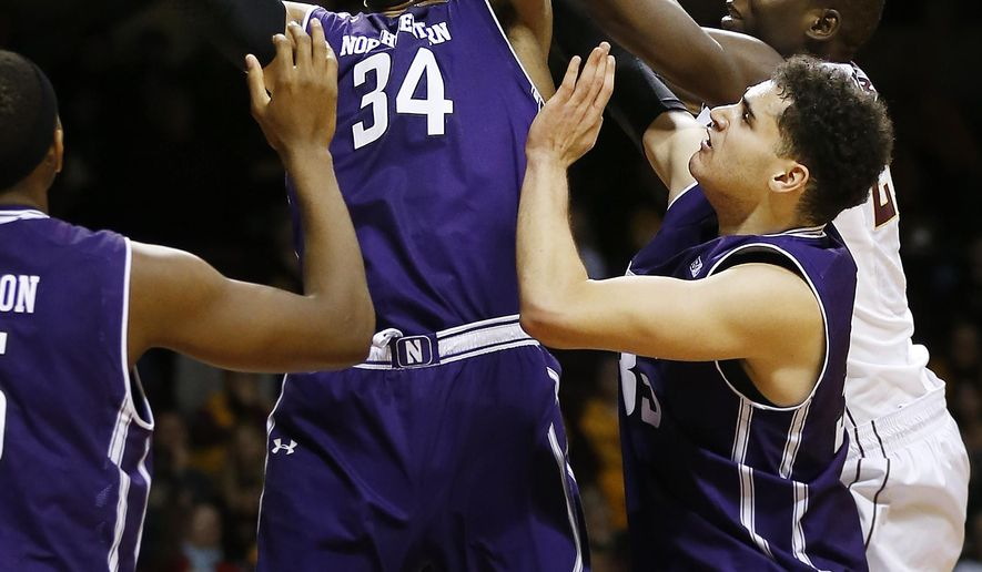 Northwestern forward Sanjay Lumpkin (34) grabs a rebound against Minnesota center Bakary Konate (21) in the second half of an NCAA college basketball game, Saturday, Jan. 9, 2016, at Williams Arena in Minneapolis. (AP Photo/Stacy Bengs)