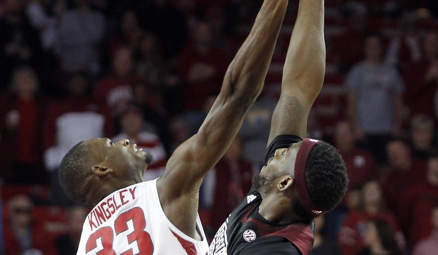 Arkansas' Moses Kingsley (33) and Mississippi State's Gavin Ware (20) fight for the ball during tip off of the first half of an NCAA college basketball game Saturday, Jan. 9, 2016, in Fayetteville, Ark. (AP Photo/Samantha Baker)