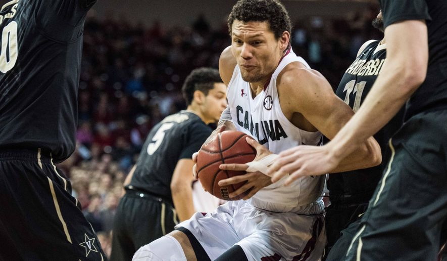 South Carolina forward Michael Carrera drives to the hoop during the first half of an NCAA college basketball game against Vanderbilt Saturday, Jan. 9, 2016, in Columbia, S.C.  (AP Photo/Sean Rayford)