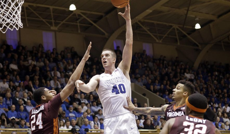 Duke's Marshall Plumlee (40) shoots over Virginia Tech's Kerry Blackshear Jr. (24), Zach LeDay (32) and Seth Allen during the second half of an NCAA college basketball game in Durham, N.C., Saturday, Jan. 9, 2016. Duke won 82-58. (AP Photo/Gerry Broome)