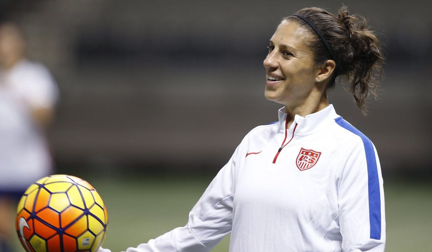 FILE - In this Dec. 15, 2015, file photo, U.S. midfielder Carli Lloyd smiles during a practice session for the team's international soccer friendly against China in New Orleans. Lloyd and defender Becky Sauerbrunn have been chosen captains of the U.S. Women's National Team.  (AP Photo/Gerald Herbert, File)