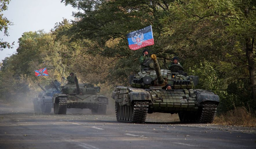 Russian troops on the eastern front continue low-intensity military operations against Ukraine. The White House is adamantly opposed to shipping lethal defensive aid with which Kiev could blunt the next Russian assault. (Associated Press)