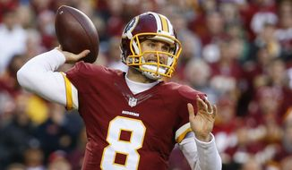 Washington Redskins quarterback Kirk Cousins (8) passes the ball during the first half of an NFL wild card playoff football game against the Green Bay Packers in Landover, Md., Sunday, Jan. 10, 2016. (AP Photo/Alex Brandon)