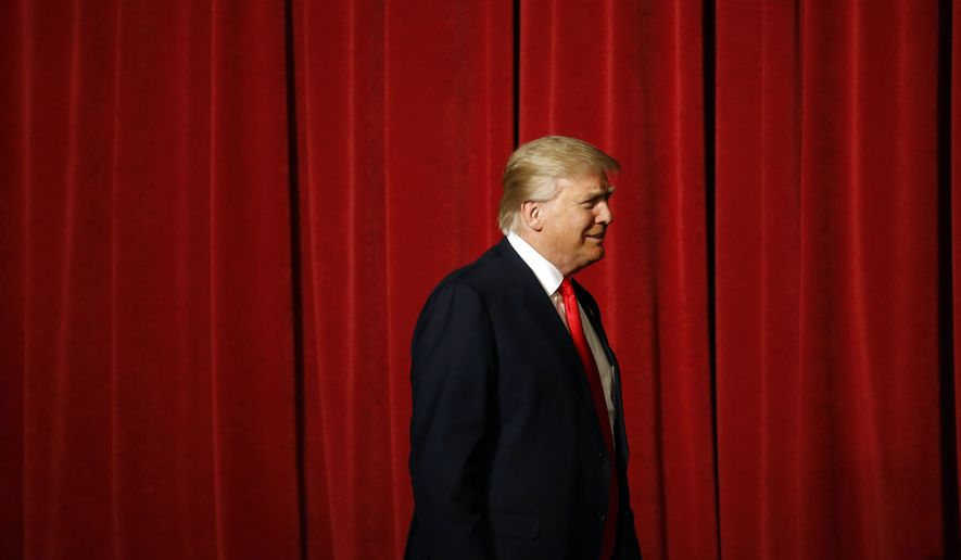 Republican presidential candidate Donald Trump walks onstage for a rally at the Surf Ballroom in Clear Lake, Iowa, Saturday, Jan. 9, 2016. (AP Photo/Patrick Semansky)