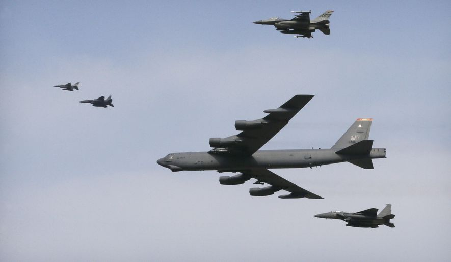 A U.S. Air Force B-52 bomber flies over Osan Air Base in Pyeongtaek, South Korea, Sunday, Jan. 10, 2016. The powerful U.S. B-52 bomber flew low over South Korea on Sunday, a clear show of force from the United States as a Cold War-style standoff deepened between its ally Seoul and North Korea following Pyongyang's fourth nuclear test. (AP Photo/Ahn Young-joon)
