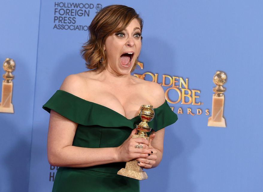 """Rachel Bloom poses in the press room with the award for best actress in a TV series, comedy or musical, for her role in """"Crazy Ex-Girlfriend"""" at the 73rd annual Golden Globe Awards on Sunday, Jan. 10, 2016, at the Beverly Hilton Hotel in Beverly Hills, Calif. (Photo by Jordan Strauss/Invision/AP)"""