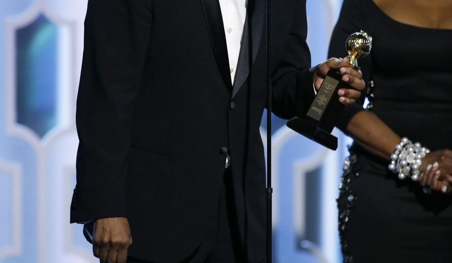 In this image released by NBC, Denzel Washington accepts the Cecil B. Demille Award  at the 73rd Annual Golden Globe Awards at the Beverly Hilton Hotel in Beverly Hills, Calif., on Sunday, Jan. 10, 2016. (Paul Drinkwater/NBC via AP)
