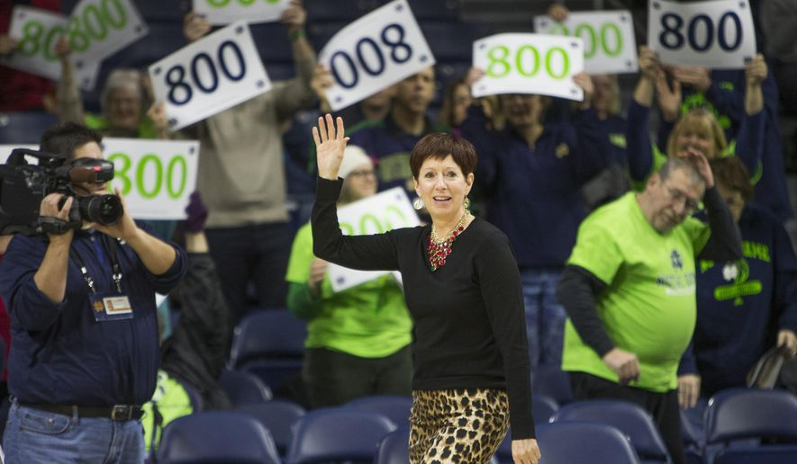 Notre Dame head coach Muffet McGraw waves to fans as she celebrates 800 career wins before an NCAA college basketball game against North Carolina on Sunday, Jan. 10, 2016, in South Bend, Ind. (AP Photo/Robert Franklin)