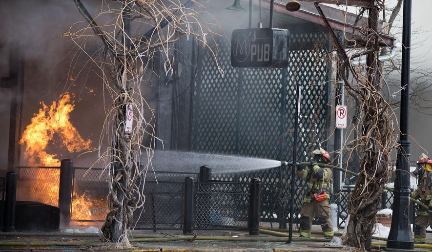 Omaha fire fighters work to extinguish a blaze at M's Pub in Omaha, Neb., Saturday, Jan. 9, 2016, in downtown Old Market. The Omaha World-Herald reported that several people called 911 to report smelling natural gas shortly before the explosion. No serious injuries from the explosion or subsequent fire have been reported. (Rebecca S. Gratz/Omaha World-Herald via AP) MAGS OUT; ALL NEBRASKA LOCAL BROADCAST TELEVISION OUT; MANDATORY CREDIT