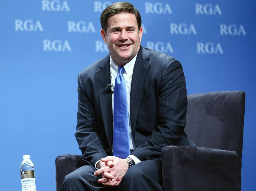 FILE - This Nov. 18, 2015, file photo, shows Arizona Gov. Doug Ducey participating in a panel discussion during the Republican Governors Association annual conference in Las Vegas. Ducey faced a massive budget deficit when he took office last year, but the tables have turned this year as relatively small budget cuts and a surge in revenue erased the deficit. He now will have a big surplus, but is vowing to maintain a tight fiscal leash on state spending despite pressure from schools and other groups to restores funding cuts. (AP Photo/Chase Stevens, File)