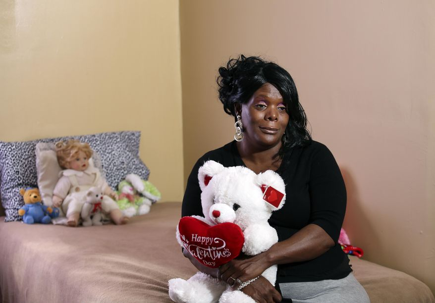 """This photo taken Nov. 11, 2015, shows Angela Renfro who runs the Kristy Love Foundation, a home designed to help victims of domestic violence and human trafficking. Renfro was abused as a kid, addicted to drugs and involved in prostitution until she was able to break free at the age of 29. After kicking her drug habit she said she could feel her heart again. """"My childhood was numb, my teenage life was numb, everything was numb and when the feeling of the numbness went a way I could see clearly and didn't want people to look at me as a prostitute."""" (Scott Utterback/The Courier-Journal via AP)"""