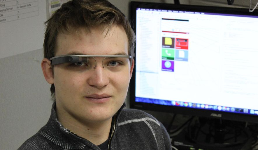 ADVANCE FOR USE SUNDAY, JAN. 10 - In this photo taken Dec. 22, 2015, Brandon Huettner, who has become somewhat of a techno-guru at Humphrey High School, poses for a photo in Humphrey, Neb. He bought himself a pair of Google glasses, the company he hopes to work for some day. (Patrick Murphy/The Norfolk Daily News via AP)  MANDATORY CREDIT