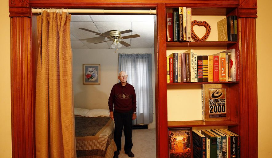 ADVANCE FOR RELEASE SUNDAY, JANUARY 10, 2016, AT 12:01 A.M. CST. AND THEREAFTER - In this Dec. 15, 2015 photo, Lawrence Nelson, chairman of the board, talks about God's Little House in Mapleton, Iowa. The two-bedroom structure has provided a rent-free, temporary home for people since 2008. (Jim Lee/Sioux City Journal via AP) MANDATORY CREDIT