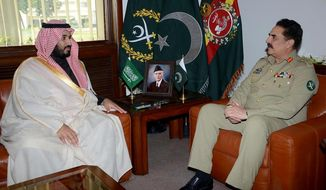 In this photo released by Inter Services Public Relations, Saudi Deputy Crown Prince and Defense Minister Mohammed bin Salman, left, meets with Pakistan army Chief Gen. Raheel Sharif in Rawalpindi, Pakistan, Sunday, Jan. 10, 2016. Pakistani army Chief has reiterated that any threat to Saudi Arabia's territorial integrity will evoke a response from Islamabad. (Inter Services Public Relatins via AP)