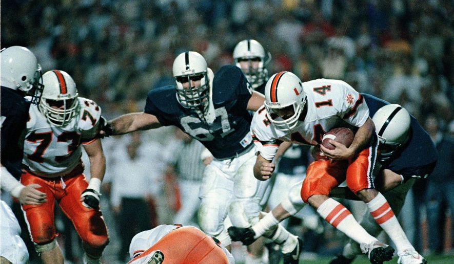 FILE - In this Jan. 2, 1987 file photo, Penn State linebacker Pete Giftopoulos, behind right, slams into Miami quarterback Vinny Testaverde (14) for a sack in the third quarter of the Fiesta Bowl in Tempe, Ariz. The game that shook the college football world saw perhaps the best Miami team assembled beaten by touchdown underdog Penn State. (AP Photo/Rob Schumacher, File)