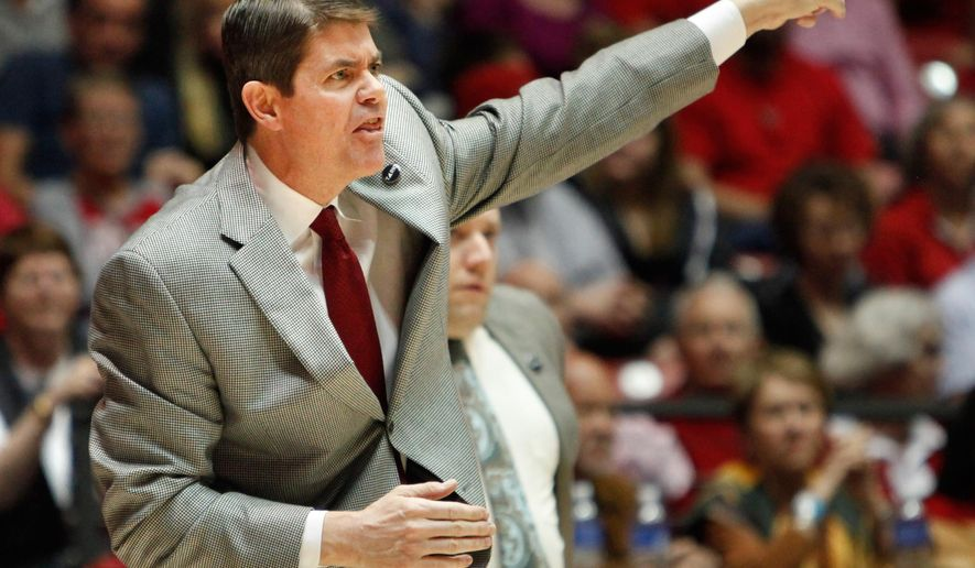 FILE - In this Feb. 21, 2015, file photo, UNLV coach Dave Rice calls a play during his team's NCAA college basketball game against New Mexico in Albuquerque, N.M. Rice has resigned in the middle of his fifth season after the struggling Runnin' Rebels opened Mountain West Conference play with three straight losses. Associate head coach Todd Simon will serve as interim coach for the rest of the season, Rebels athletic director Tina Kunzer-Murphy announced Sunday night, Jan. 10, 2016. (AP Photo/Eric Draper, File)
