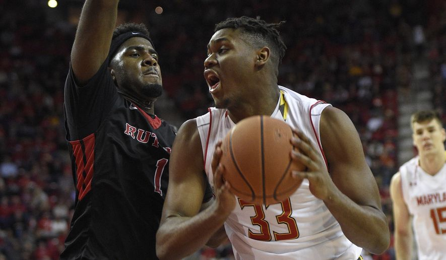 Maryland center Diamond Stone (33) drives to the basket against Rutgers forward D.J. Foreman (1) during the second half of an NCAA college basketball game, Wednesday, Jan. 6, 2016, in College Park, Md. Maryland won 88-63. (AP Photo/Nick Wass)
