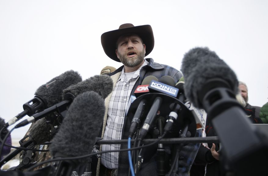 Ammon Bundy, despite leading an armed group occupying a national wildlife refuge in Oregon, says his siege will ultimately serve to head off violent conflict with the government. (Associated Press)