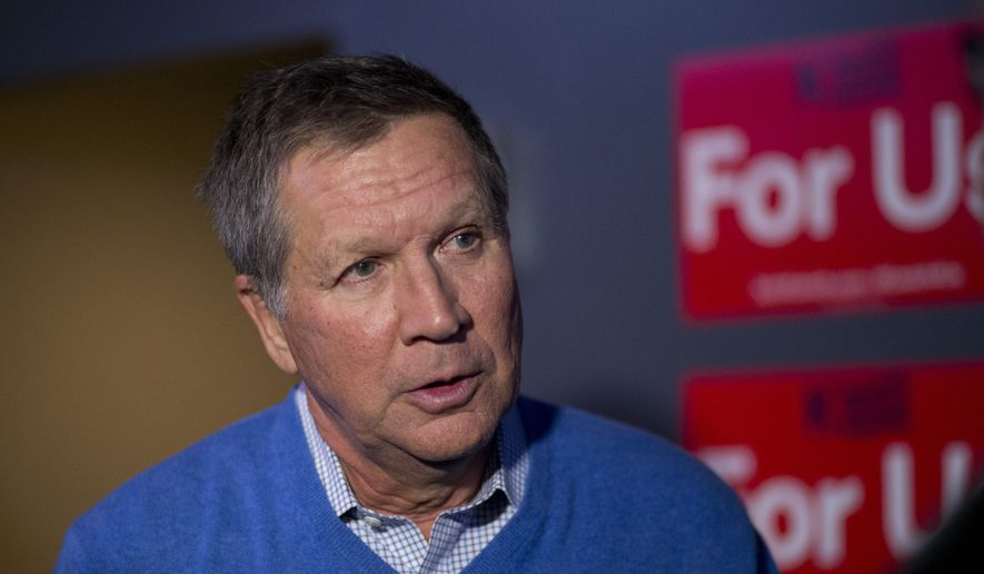 Republican presidential candidate, Ohio Gov. John Kasich chats with a supporter after his campaign event, Sunday, Jan. 10, 2016, in Council Bluffs, Iowa. (AP Photo/Jae C. Hong)