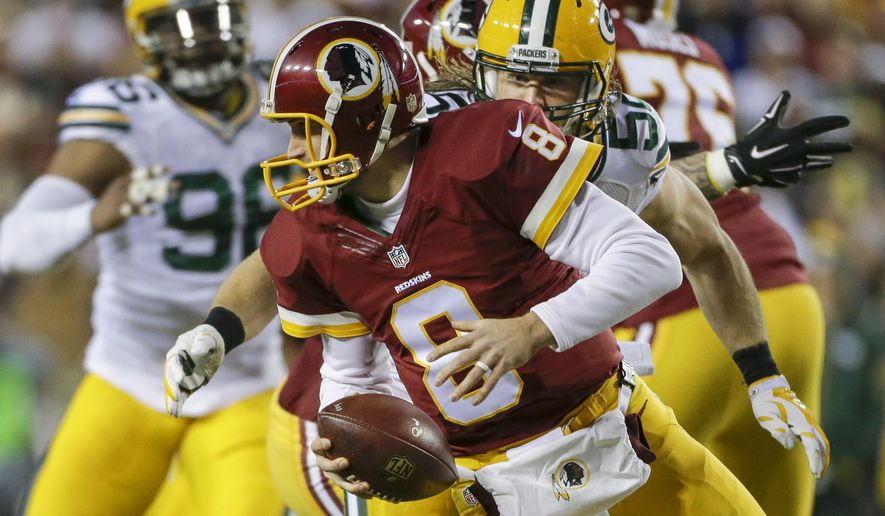 Green Bay Packers inside linebacker Clay Matthews (52) closes in on the sack of Washington Redskins quarterback Kirk Cousins (8) during the first half of an NFL wild card playoff football game in Landover, Md., Sunday, Jan. 10, 2016. (AP Photo/Mark Tenally)