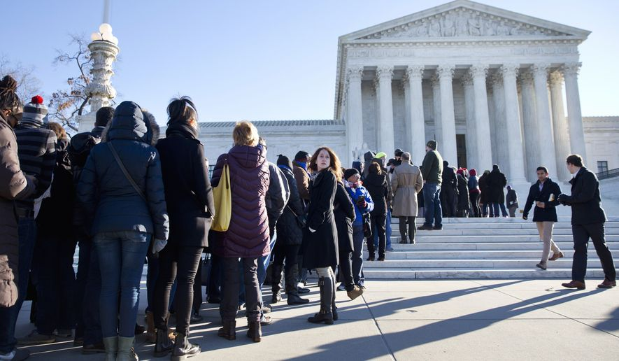 People stand in line hoping to enter the Supreme Court in Washington, Monday, Jan. 11, 2016, for arguments in the 'Friedrichs v. California Teachers Association' case. The justices were to hear arguments in a case that challenges the right of public-employee unions to collect fees from teachers, firefighters and other state and local government workers who choose not to become members.  (AP Photo/Jacquelyn Martin)