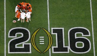Clemson players huddle before the NCAA college football playoff championship game against Alabama Monday, Jan. 11, 2016, in Glendale, Ariz. (AP Photo/Ross D. Franklin)
