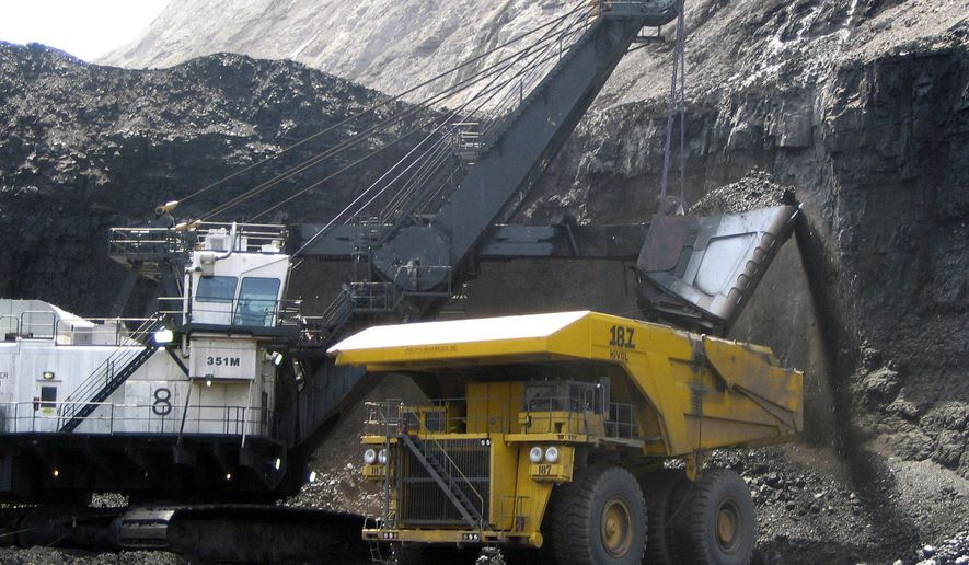 FILE - In this April 30, 2007, file photo, a shovel prepares to dump a load of coal into a 320-ton truck at the Black Thunder mine in Wright, Wyo. The mine is owned by St. Louis-based Arch Coal Inc. which says its Chapter 11 filing will not affect employee pay or benefits while the company reorganizes its debt. (AP Photo/Matthew Brown, File)