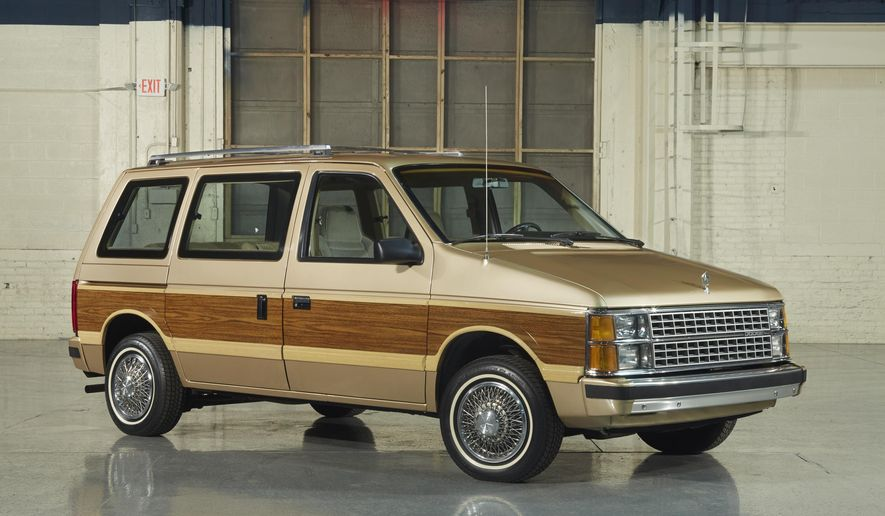 This photo provided by Fiat Chrysler Automobiles shows the 1984 Dodge Caravan minivan. Chrysler introduced the minivan 33 years ago, and it took the suburbs by storm. The sliding doors and roomy interior in the Chrysler Town and Country and the Dodge Caravan were perfect for shuttling kids and their sports gear. (Courtesy of Fiat Chrysler Automobiles)