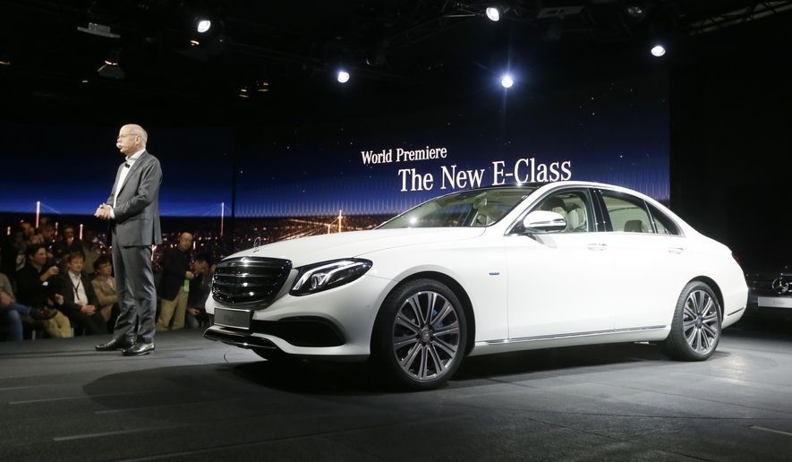 Dr. Dieter Zetsche, chairman of the board of management Daimler AG and Head of Mercedes-Benz Cars addresses the media as the automaker unveils the new E-Class sedan during a preview night for the North American International Auto Show, Sunday, Jan. 10, 2016 in Detroit. (AP Photo/Carlos Osorio)