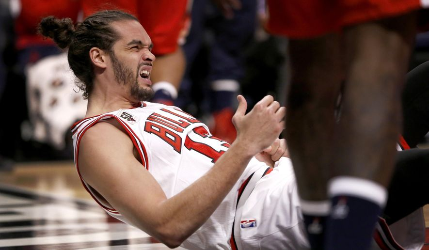 Chicago Bulls center Joakim Noah gets up off the floor after falling on his left shoulder during the second half of an NBA basketball game against the Washington Wizards, Monday, Jan. 11, 2016, in Chicago. Noah returned from a shoulder injury on Monday night against Washington, providing another option for coach Fred Hoiberg heading into a busy stretch. Noah sprained his left shoulder during a loss to Brooklyn on Dec. 21. (AP Photo/Charles Rex Arbogast)
