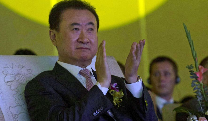 FILE - In this June 19, 2013, file photo, Wanda Chairman Wang Jianlin applauds during an event at a hotel in Beijing, China. Chinese conglomerate Wanda Group announced Tuesday, Jan. 12, 2016, it has agreed to buy Hollywood film company Legendary Entertainment for $3.5 billion in what it said is China's biggest foreign cultural acquisition to date. (AP Photo/Ng Han Guan, File)