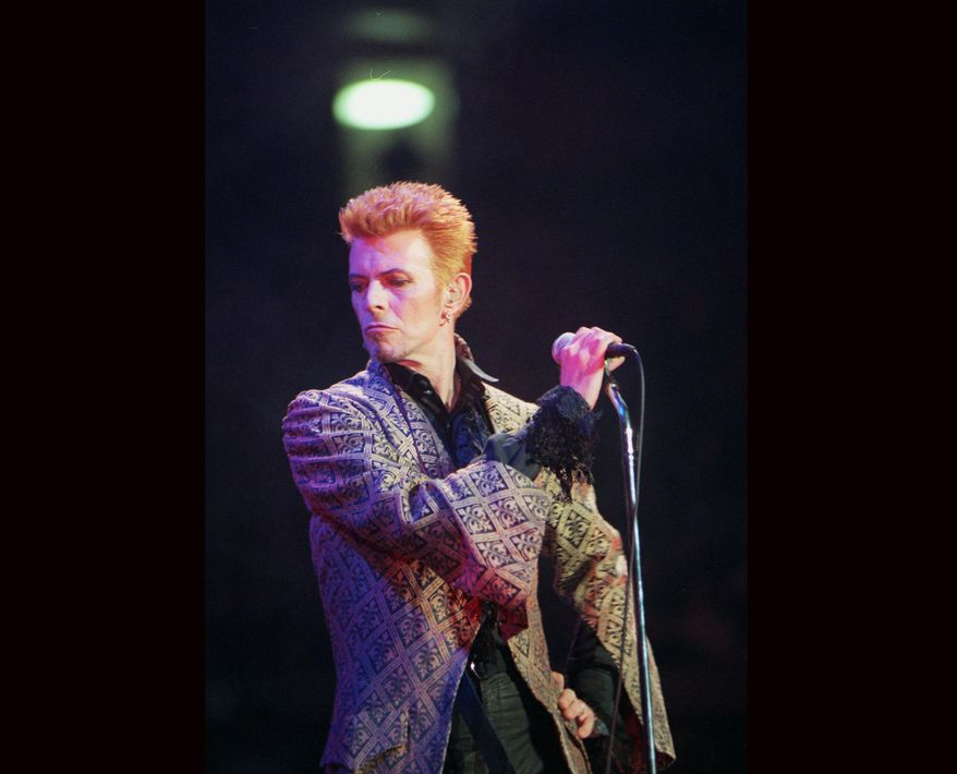 CORRECTS DATE OF DEATH TO SUNDAY, JAN. 10, 2016 - FILE - In this Jan. 9, 1997, file photo, David Bowie performs during a concert celebrating his 50th birthday, at Madison Square Garden in New York. Bowie, the innovative and iconic singer whose illustrious career lasted five decades, died Sunday, Jan. 10, 2016, after battling cancer for 18 months. He was 69. (AP Photo/Ron Frehm, File)