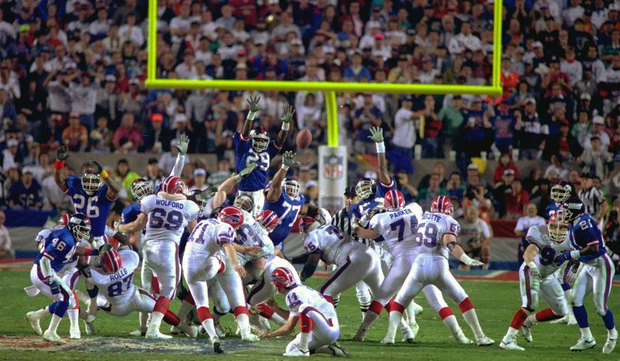 FILE- In this Jan. 27, 1991, file photo, Buffalo Bills kicker Scott Norwood, center, misses the field goal on the last play of the game, clinching the victory for the New York Giants in Super Bowl XXV in Tampa. The Giants won 20-19. (AP Photo/Phil Sandlin, File)