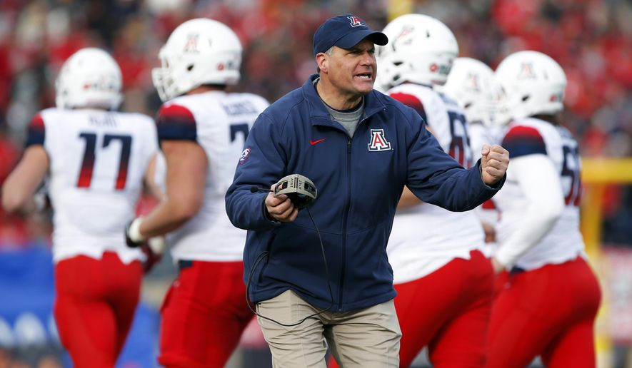 FILE - In this Dec. 19, 2015, file photo, Arizona head coach Rich Rodriguez encourages his players during a timeout in the second half of the New Mexico Bowl NCAA college football game against New Mexico in Albuquerque, N.M. Rodriguez hears it all the time. He could be at the grocery store, gas station, a restaurant and inevitably someone will come up to him with a suggestion for a play or a new scheme. (AP Photo/Andres Leighton, File)