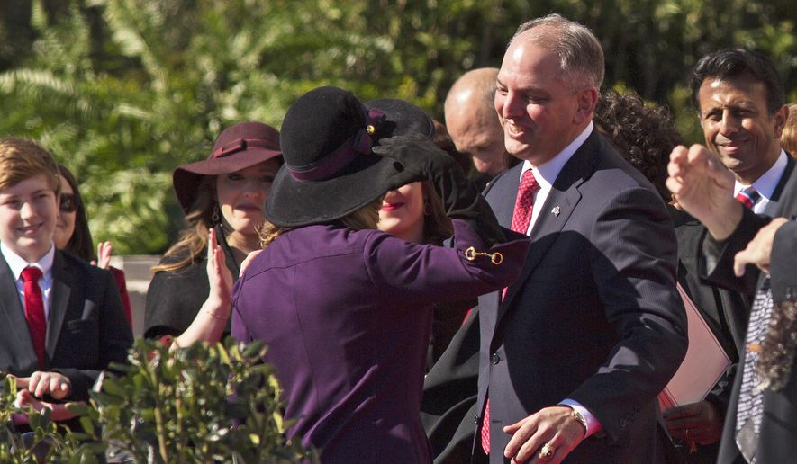 John Bel Edwards hugs his wife after taking the oath of office as Louisiana governor on the steps of the Louisiana Capitol in Baton Rouge, La., Monday, Jan. 11, 2016. Edwards is Louisiana's 56th governor. (AP Photo/Max Becherer, Pool)