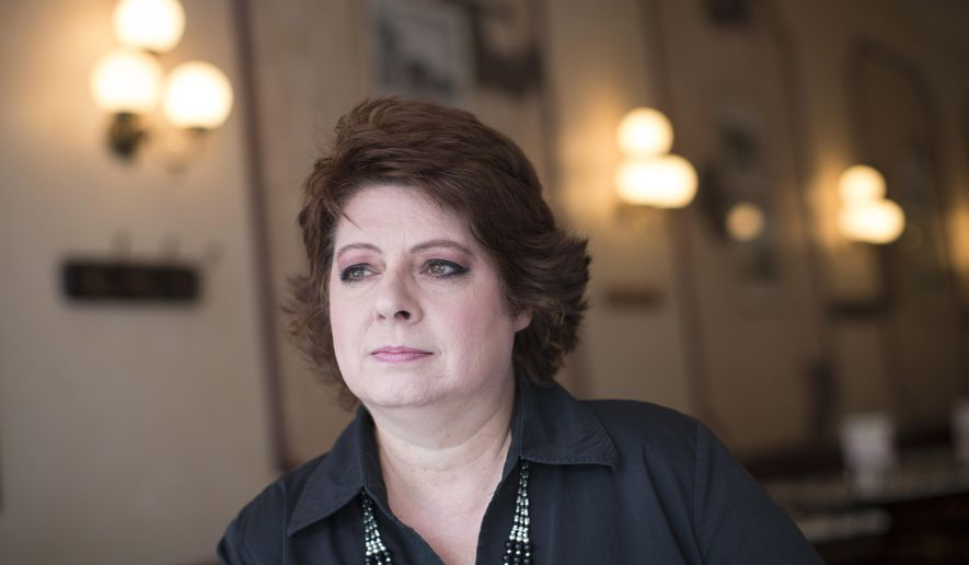 FILE - In this file photo taken Aug. 5, 2015, Lori Viars, a longtime conservative activist in Warren County, Ohio, sits for a portrait at Village Ice Cream Parlor in Lebanon, Ohio. Viars is among three dozen prominent conservative activists in Ohio who said Monday, Jan. 11, 2016, they are backing U.S. Sen. Ted Cruz of Texas for president, releasing a joint announcement three days after the state's Republican Party formally endorsed Ohio Gov. John Kasich. (AP Photo/John Minchillo, File)