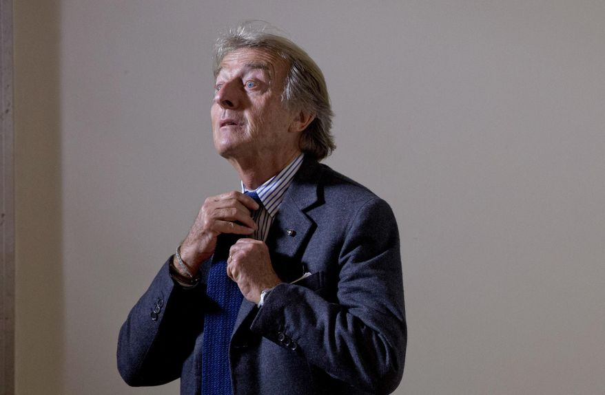 """Rome 2024 Olympic bid committee chairman Luca Cordero di Montezemolo adjusts his tie as he arrives for a press conference at the foreign press association in Rome, Monday, Jan. 11, 2016. The chairman of Rome's bid for the 2024 Olympics doesn't see the """"necessity"""" for a public referendum on the candidacy. Luca Cordero di Montezemolo points out that Rome's city council voted """"nearly unanimously"""" in support of the bid last year, """"and the government has expressed maximum support, so we don't see the necessity."""" (AP Photo/Alessandra Tarantino)"""