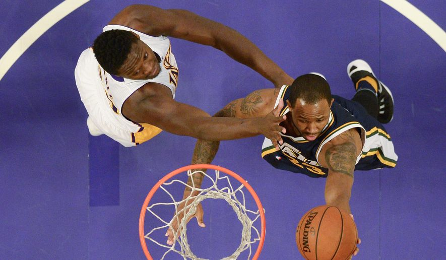 Utah Jazz forward Chris Johnson, right, shoots as Los Angeles Lakers forward Julius Randle defends during the first half of an NBA basketball game Sunday, Jan. 10, 2016, in Los Angeles. (AP Photo/Mark J. Terrill)
