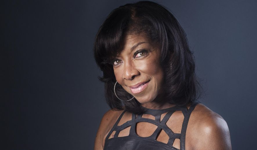 """FILE- In a Wednesday, June 26, 2013 file photo, Grammy winning singer-songwriter Natalie Cole poses for a portrait in promotion of her new album """"Natalie Cole en Espanol,"""" in New York. Cole's life is celebrated during a funeral on Monday, Jan. 11, 2016, for the late R&B singer, who died on New Year's Eve at age 65. Family and friends gather to bid farewell to the daughter of crooner Nat King Cole who established her Grammy Award-winning career before intertwining her father's musical legacy with her own in their hit """"Unforgettable.""""  (Photo by Victoria Will/Invision/AP, File)"""