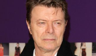 David Bowie attends the 2010 CFDA Fashion Awards in New York, in this June 7, 2010, file photo. Bowie, the innovative and iconic singer whose illustrious career lasted five decades, died Monday, Jan. 11, 2016, after battling cancer for 18 months. He was 69. (AP Photo/Peter Kramer, File)