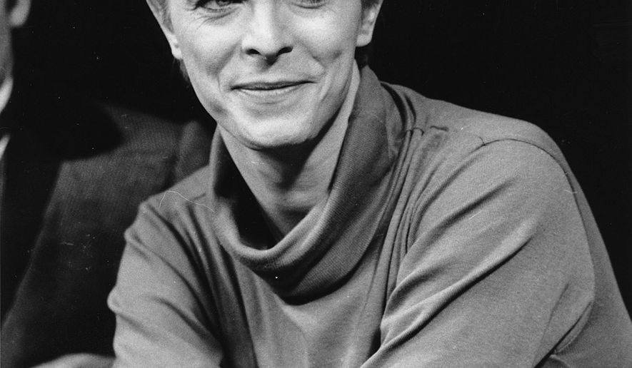"FILE i In this Sept. 17, 1980, file photo, David Bowie listens during a news conference after a rehearsal at the Booth Theater in New York.  Bowie was appearing in the Broadway production of ""The Elephant Man."" Bowie, the innovative and iconic singer whose illustrious career lasted five decades, died Monday, Jan. 11, 2015, after battling cancer for 18 months. He was 69. (AP Photo/Marty Lederhandler, FIle)"