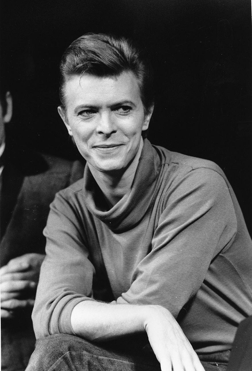 """FILE i In this Sept. 17, 1980, file photo, David Bowie listens during a news conference after a rehearsal at the Booth Theater in New York.  Bowie was appearing in the Broadway production of """"The Elephant Man."""" Bowie, the innovative and iconic singer whose illustrious career lasted five decades, died Monday, Jan. 11, 2015, after battling cancer for 18 months. He was 69. (AP Photo/Marty Lederhandler, FIle)"""