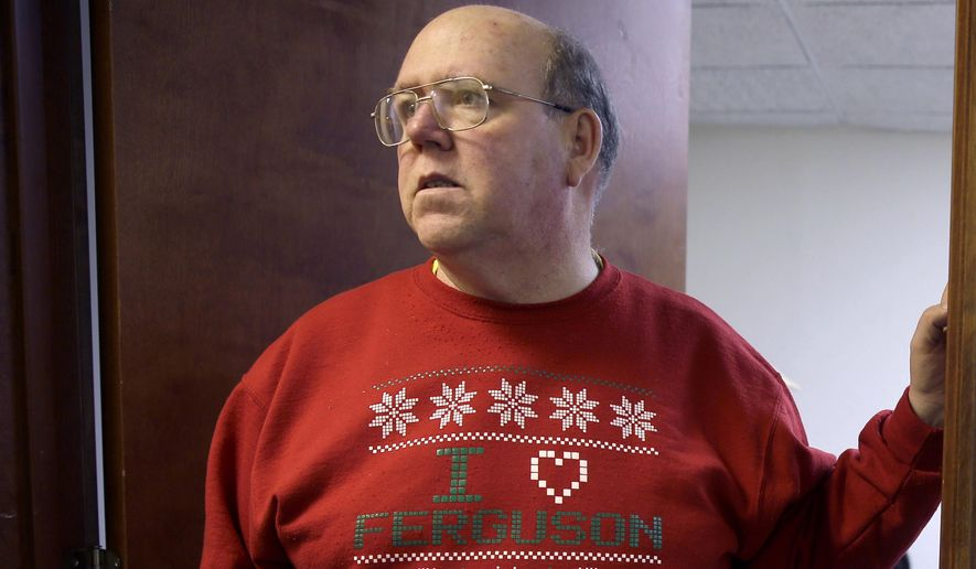 FILE - This Dec. 8, 2014 file photo shows Brian Fletcher wearing an I Love Ferguson sweater in Ferguson, Mo. Fletcher, a Ferguson city councilman and former mayor who was the driving force behind the I Love Ferguson campaign that began amid the turmoil that followed the fatal police shooting of 18-year-old Michael Brown has died. City officials confirmed Fletcher died Sunday, Jan. 10, 2016, but say the cause of death is unknown. (AP Photo/Jeff Roberson, File)