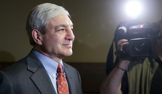 FILE - In this Wednesday, May 21, 2014, file photo, former Penn State President Graham Spanier walks from a hearing before a Superior Court panel at City Hall in Philadelphia. A judge, on Monday, Jan. 11, 2016, cleared the way for Spanier to pursue a defamation lawsuit against an ex-FBI director whose team issued a university-commissioned report critical of Spanier for his handling of complaints about Jerry Sandusky. (AP Photo/Matt Rourke, File)
