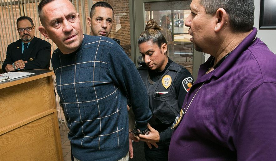 Stephen Siddall is arrested by Las Cruces Police Department Detective Robert Campos, right, and LCPD officer Veronica De La O on Monday, Jan. 11, 2016, at 3rd Judicial District Court on charges of embezzlement in the Sen. Mary Kay Papen case. In the moments prior to the arrest, Siddall was in court before Judge Mary W. Rosner for arraignment in a embezzlement case concerning Papen's son-in-law, City Councilor Greg Smith.  (Robin Zielinski/Las Cruces Sun-News via AP)